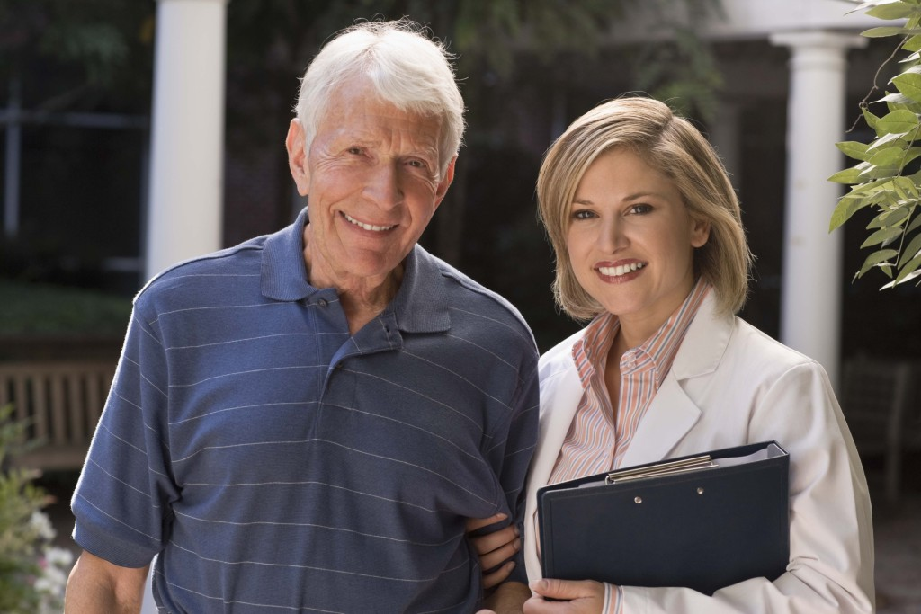 Portrait of doctor and elderly man outdoors